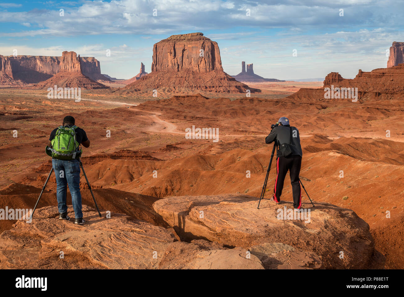 Monument Valley is a region of the Colorado Plateau characterized by a cluster of vast sandstone buttes, the largest reaching 1,000 ft (300 m) above t Stock Photo