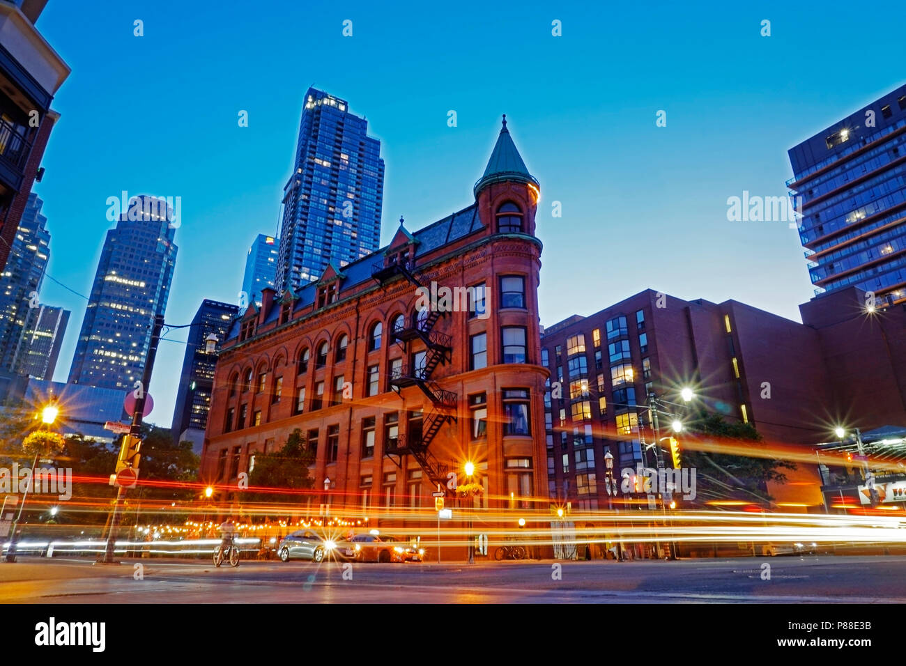 Toronto downtown landmark Flatiron Building, also known as Gooderham Building at the corner of Front Street, Church Street and Wellington Street - Stock Image