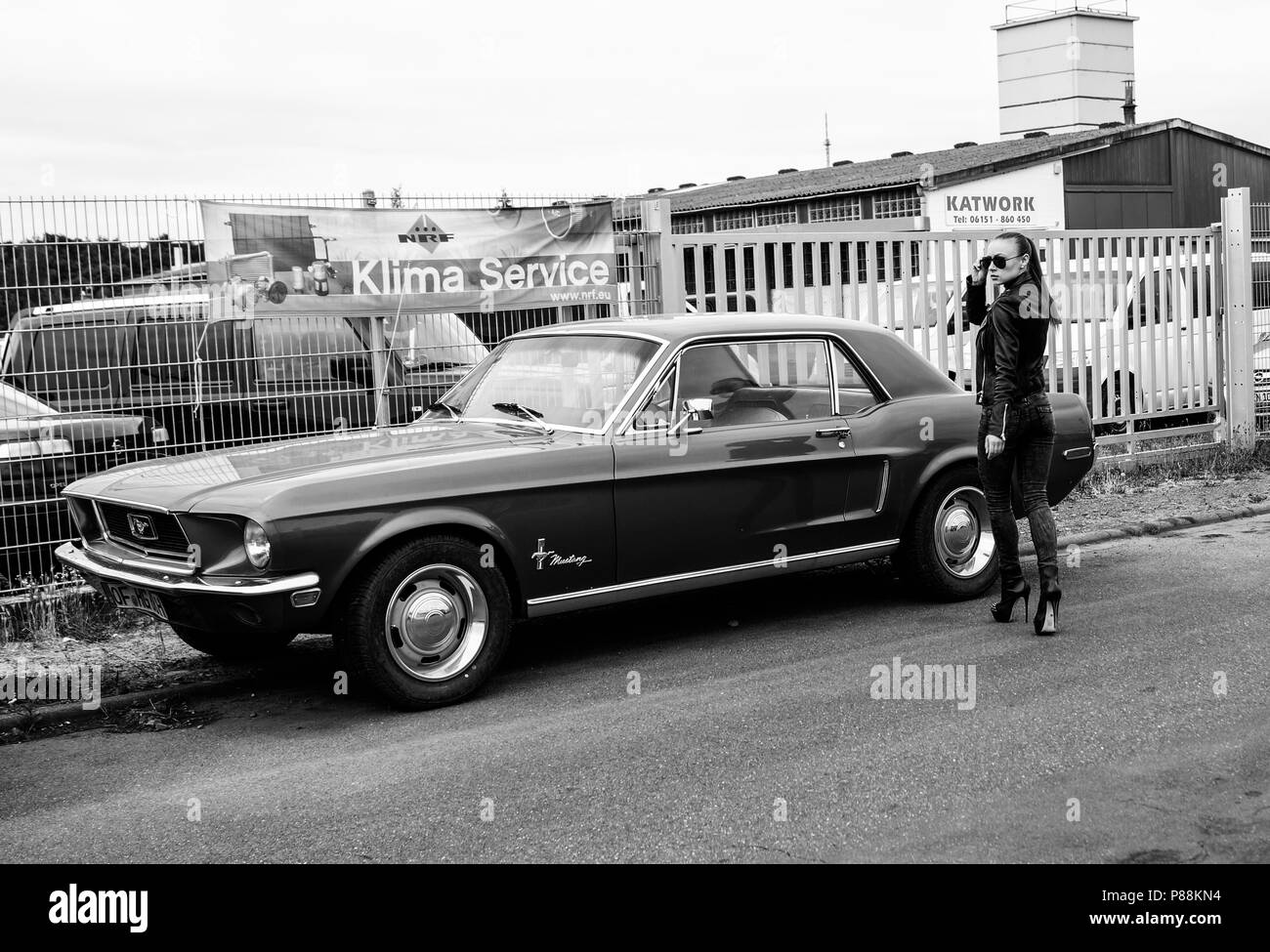 Female model and old car ford mustang