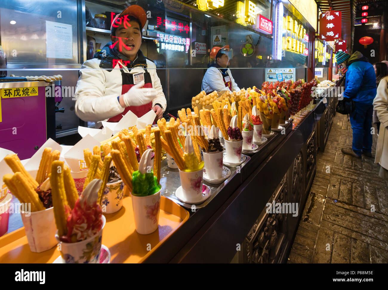 People at the Wangfujing Snack Street in Beijing - Stock Image