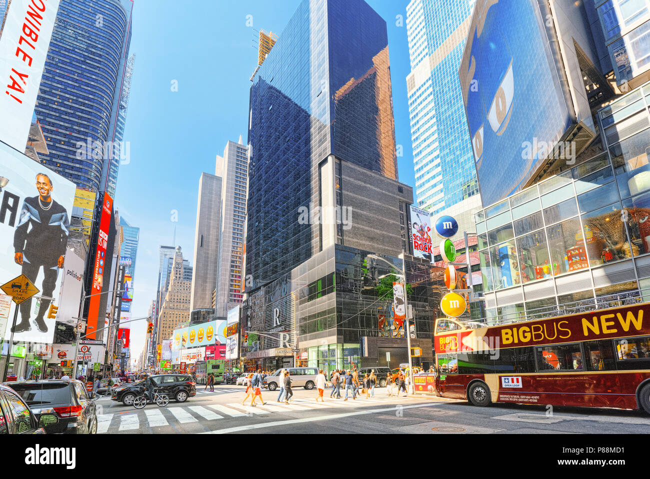 New York, USA- August 14, 2017 : 7 th Avenue and  Candy Store M&M's in  New York near Times Square.Street, cars, people and tourists on it. - Stock Image