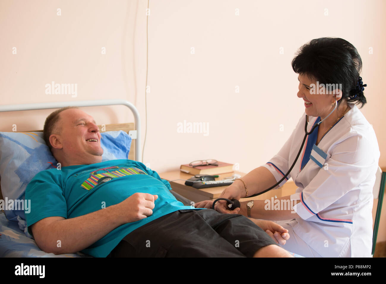 Belarus, Gomel, 24 April 2018. The Gomel Central Hospital.The doctor measures the pressure on the patient - Stock Image
