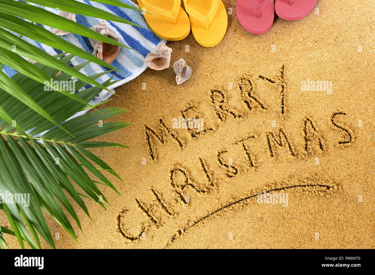 merry christmas message written in sand on a sunny tropical beach christmas beach vacation concept - Merry Christmas Beach Images