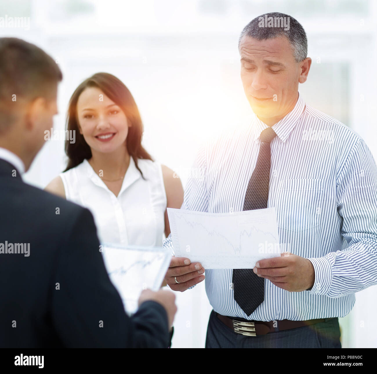 group of business people discussing an important document. - Stock Image