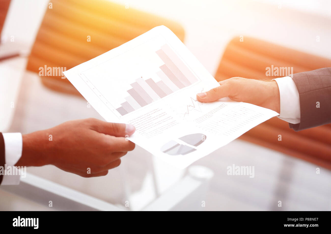 Business people discussing financial graphs - Stock Image