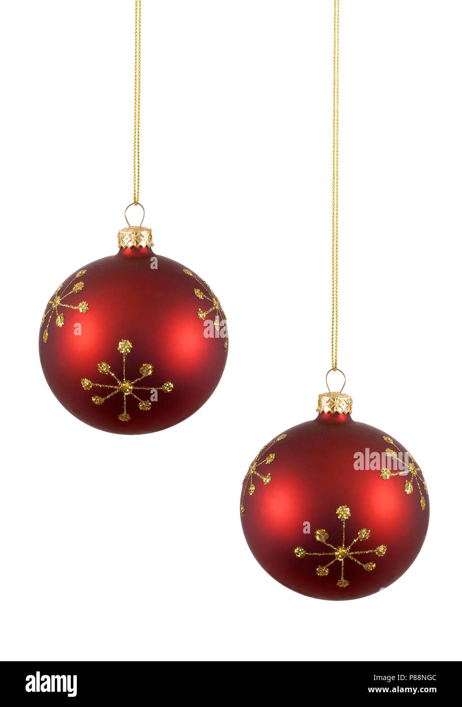 two red christmas balls or baubles with gold snowflake pattern isolated against white background - Red Christmas Balls