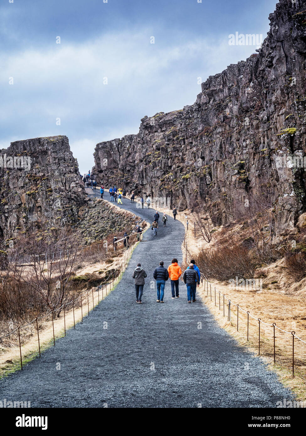 19 April 2018: Thingvellir National Park, Iceland - Visitors walking in the Almannagja Canyon which runs through this National Park, one of the major  - Stock Image