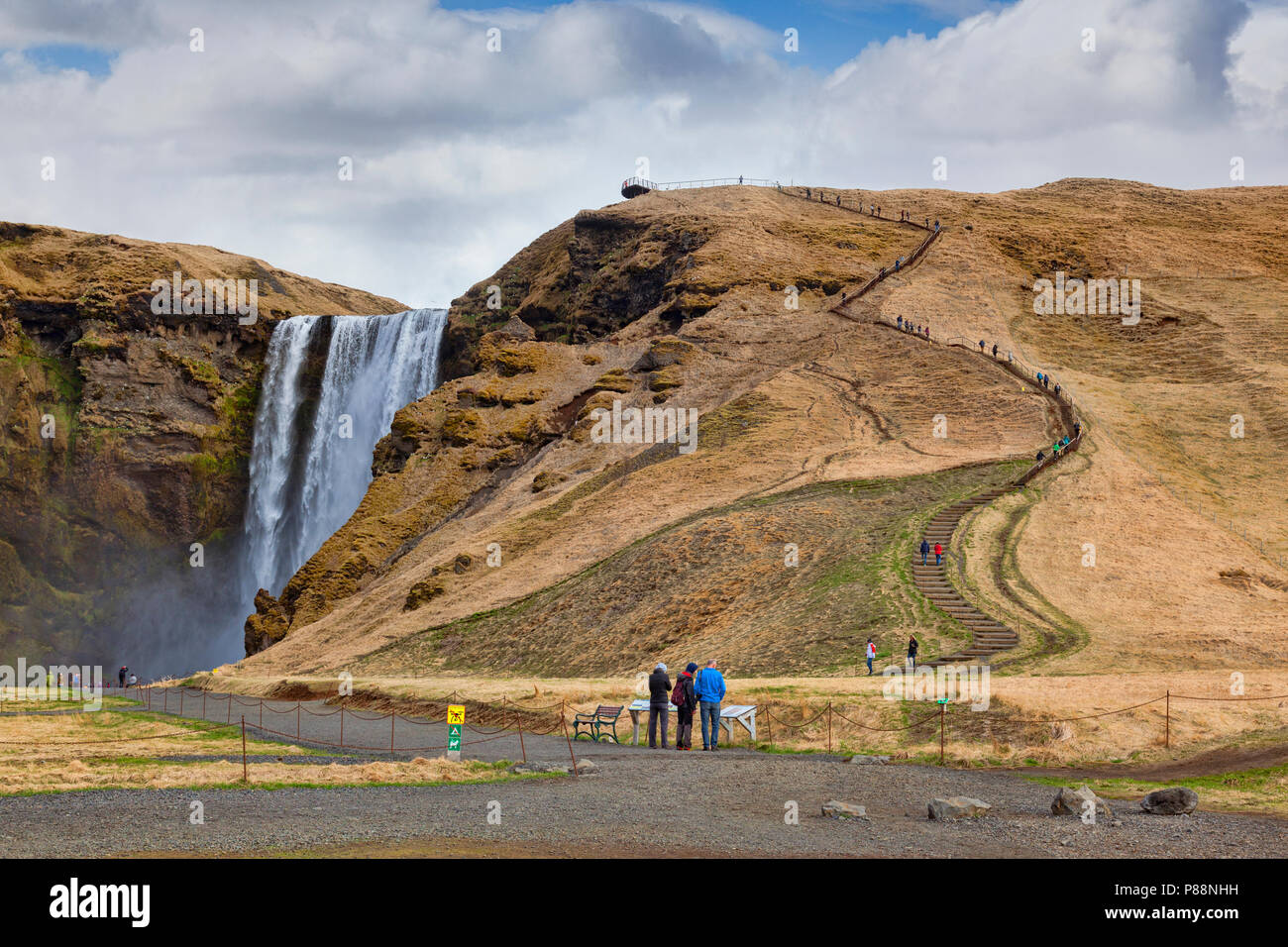 22 April 2018: Skogar, South Iceland - Skogafoss waterfall, and the staircase up to the viewing platform. - Stock Image