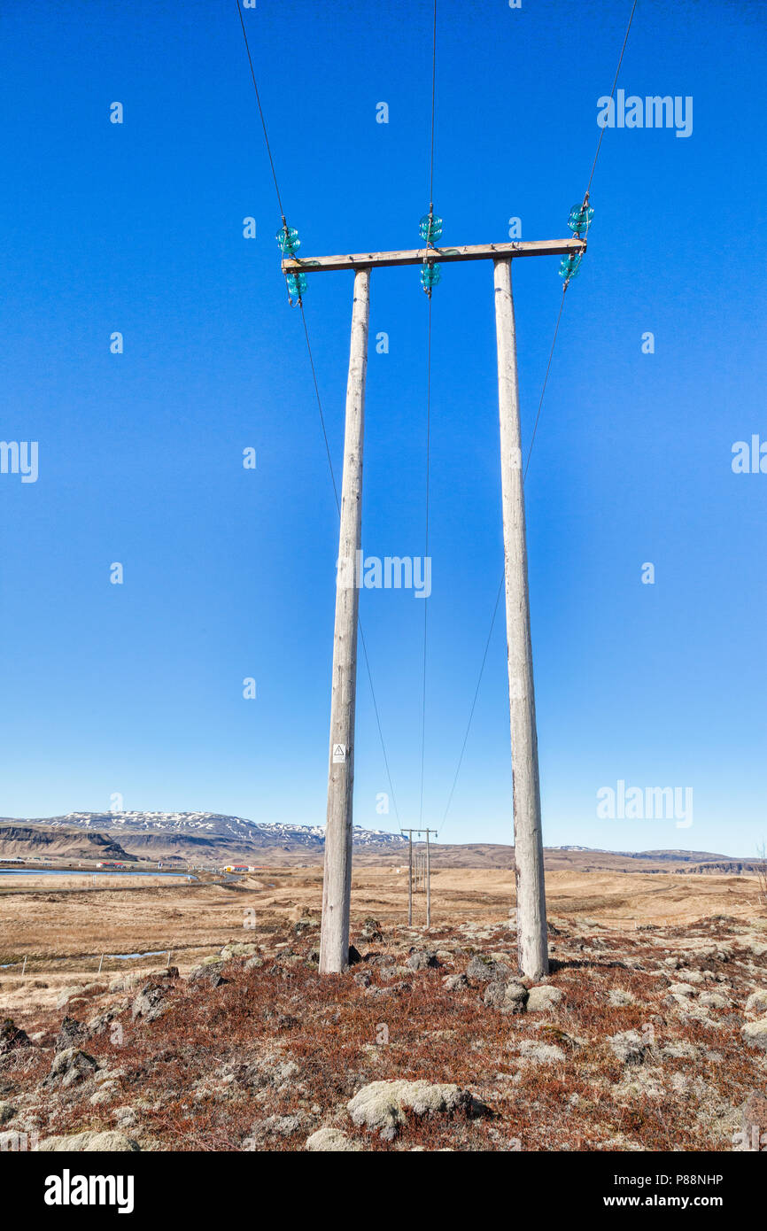 Pylons on the south coast of Iceland and beautiful blue sky. - Stock Image