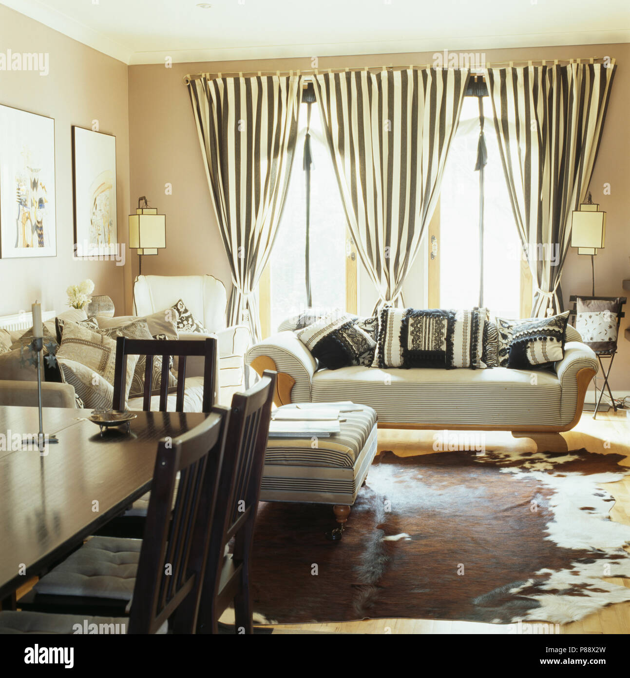 Black White Striped Curtains On Windows Behind Sofa In Living And Dining Room With Animal Skin Rug The Floor