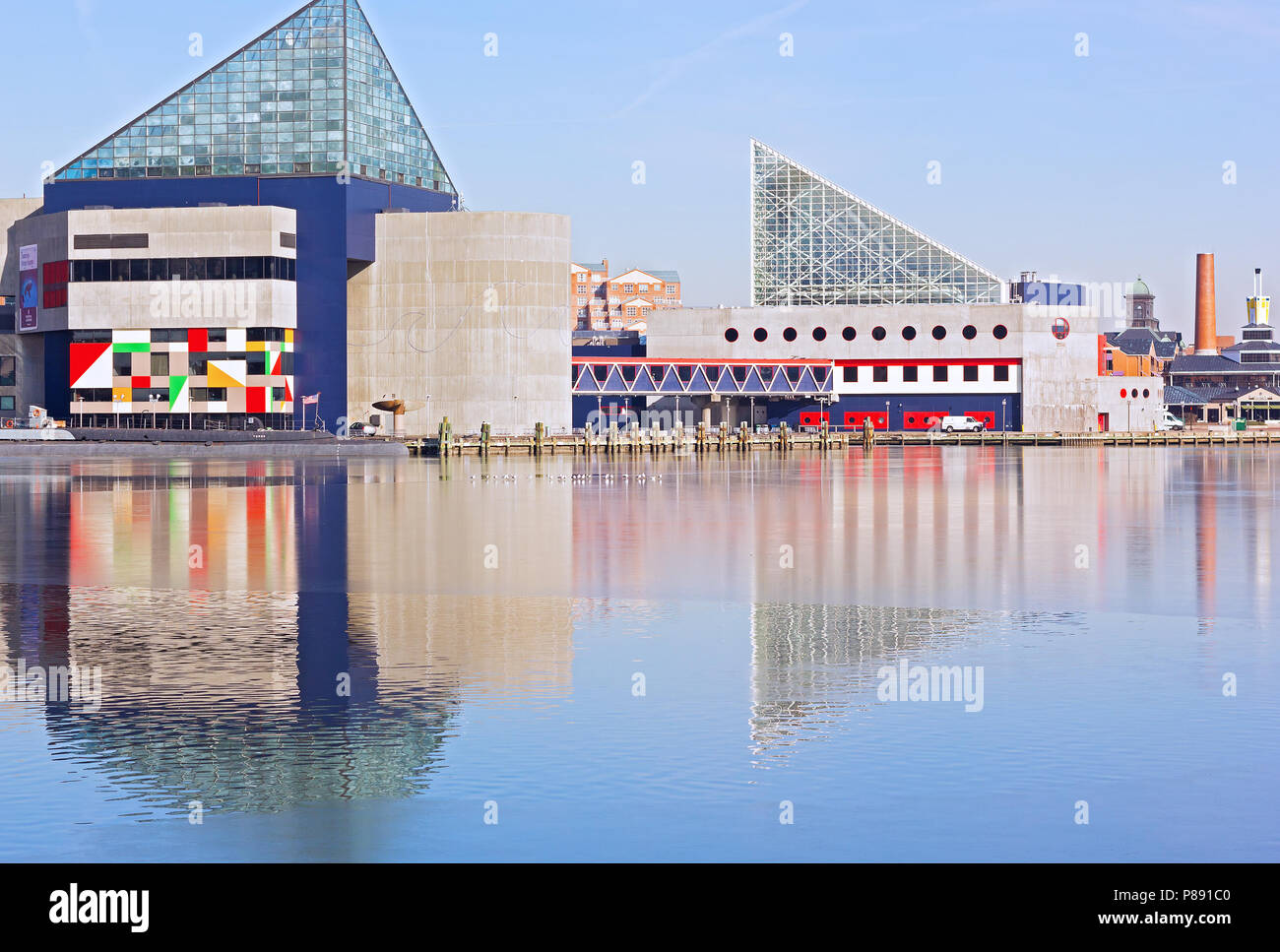 BALTIMORE, USA - JANUARY 31, 2014: National Aquarium and historic submarine Torsk at Inner Harbor on January 31, 2014 in Baltimore, USA. The landmarks - Stock Image