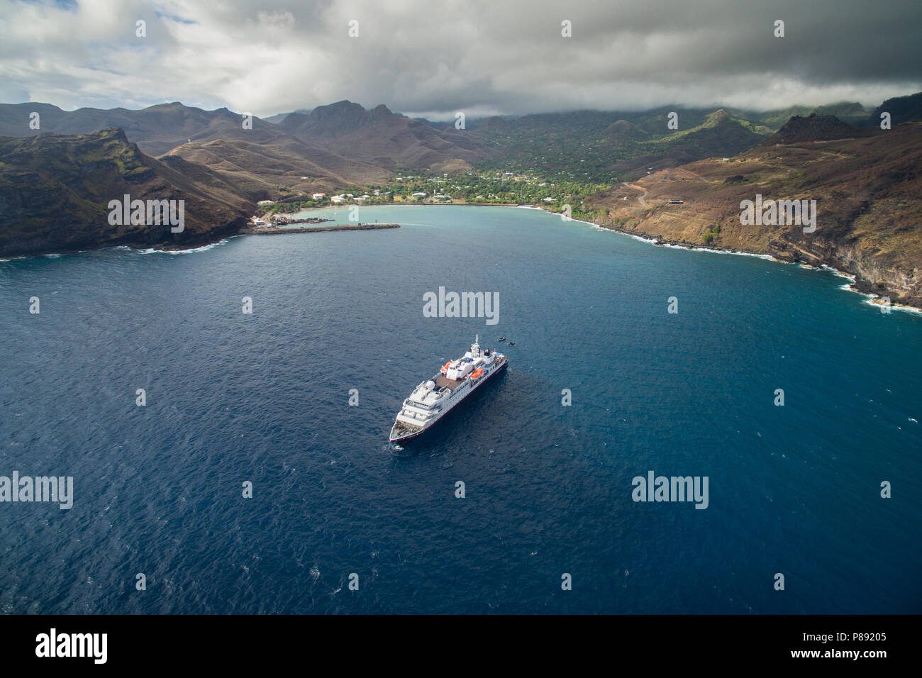 Cruise Ship anchored at Ua Pou, Marquesas Islands - Stock Image