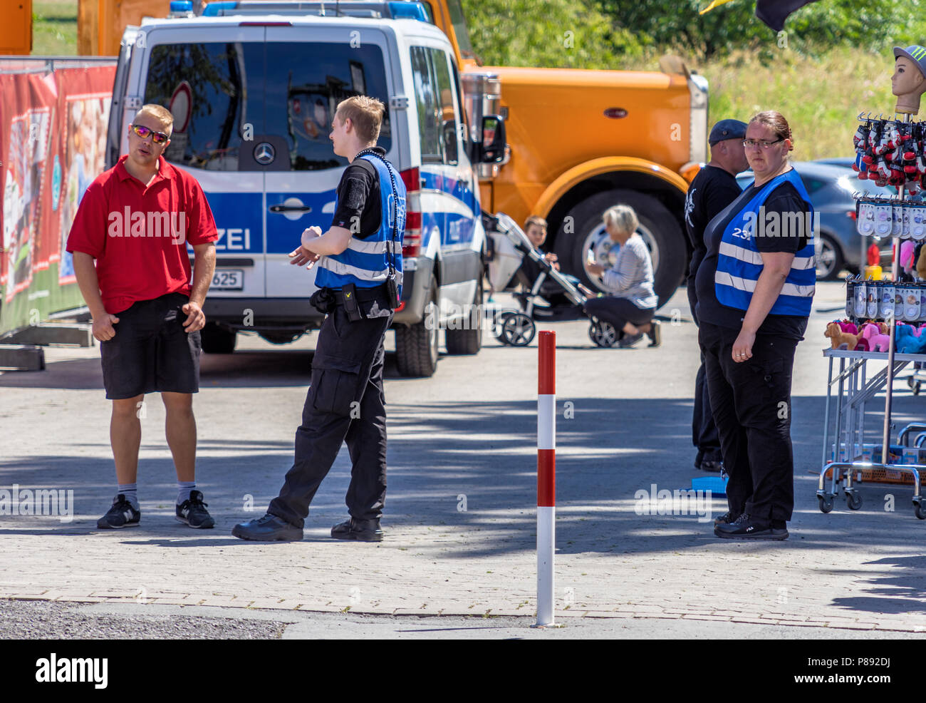 Hannover, Germany, July 7., 2018: German police secure the entrances at the shooting festival - Stock Image