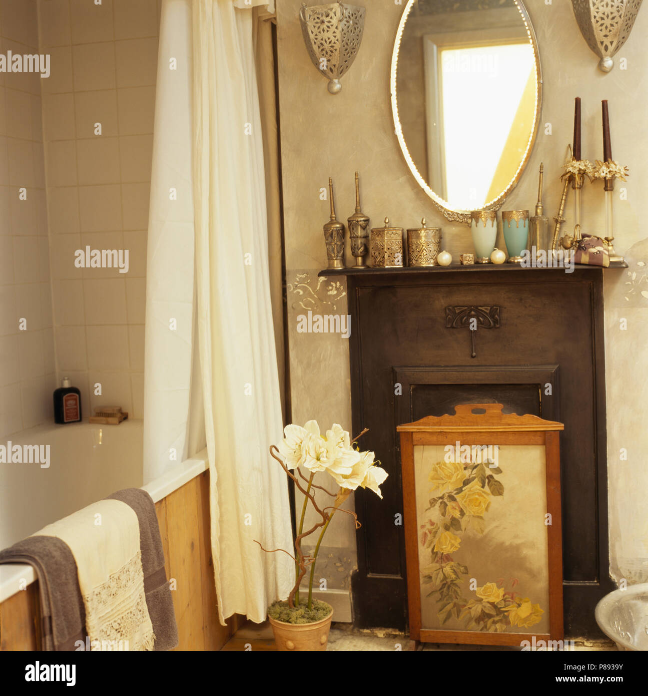 Oval Mirror Above Small Cast Iron Fireplace With Victorian Firescreen In Bathroom Shower Curtain Bath