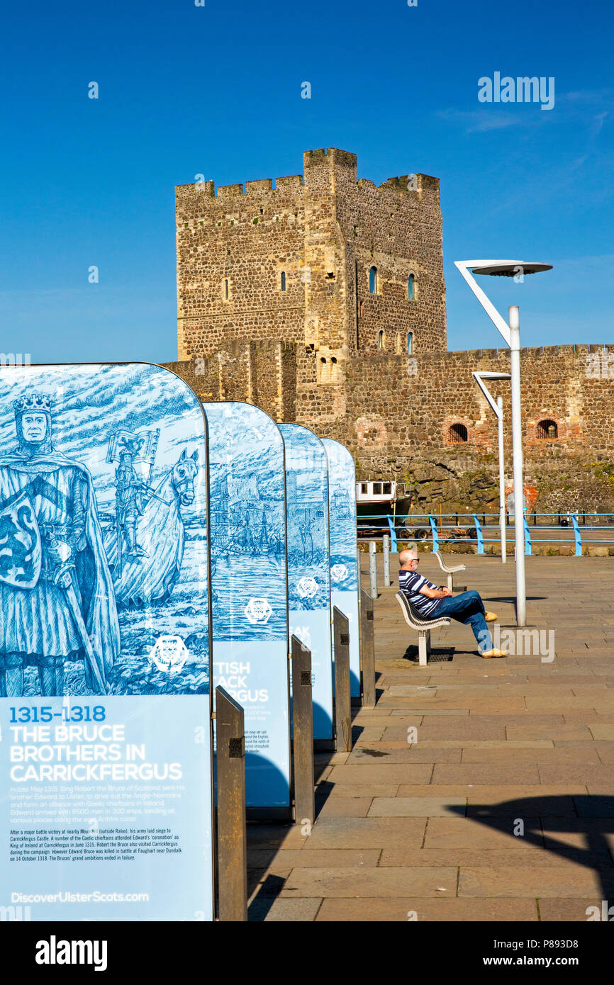 UK, Northern Ireland, Co Antrim, Carrickfergus, Norman Castle and historical information boards - Stock Image