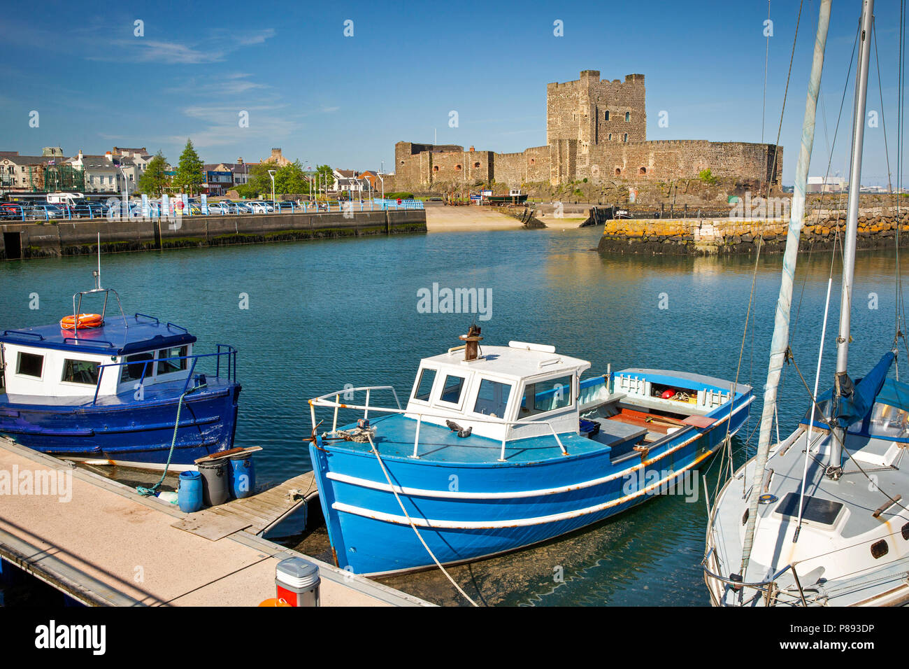UK, Northern Ireland, Co Antrim, Carrickfergus, Norman Castle from across the harbour at high tide - Stock Image