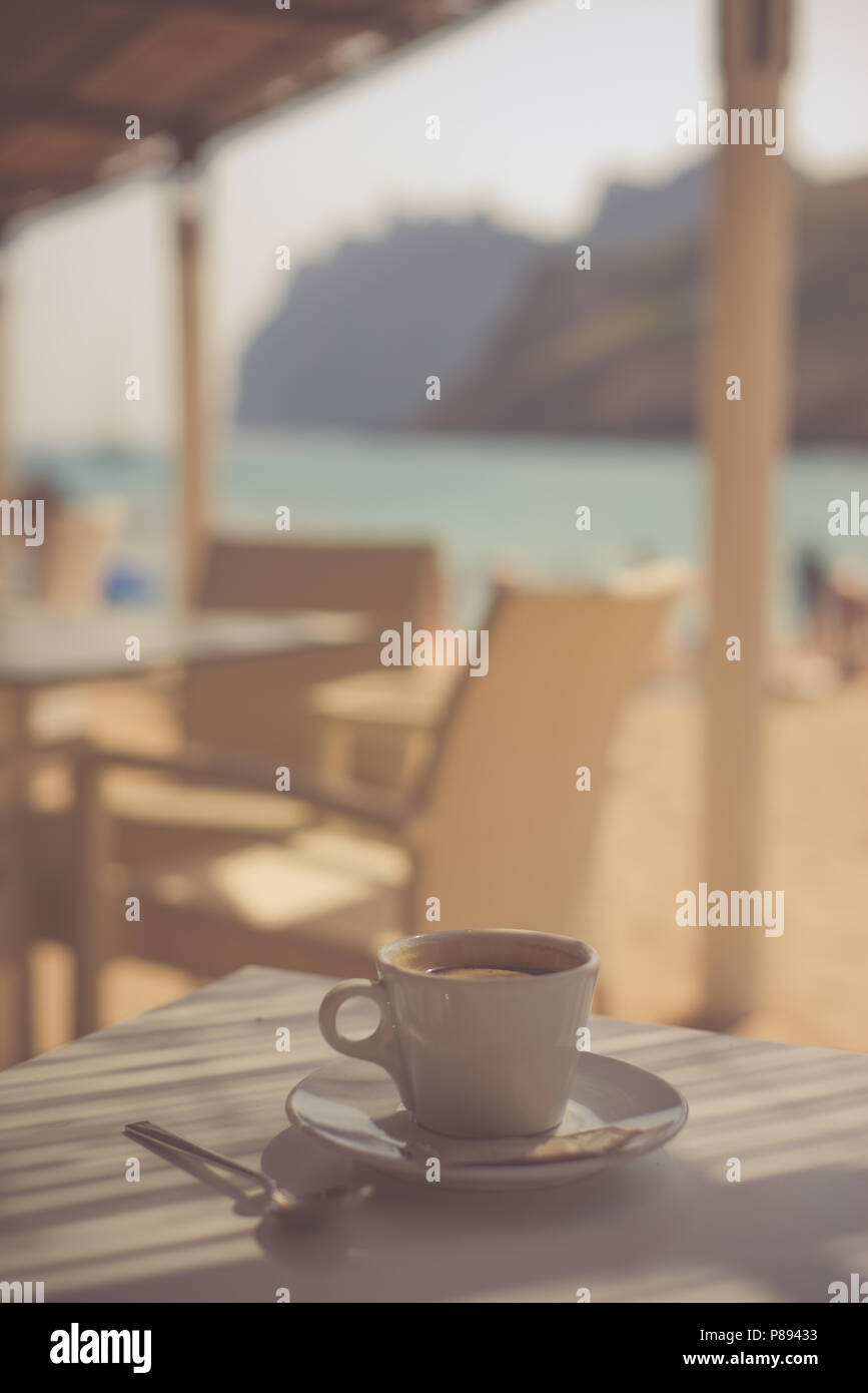 View of Turquoise Sea and Mountains from a Beach Cafe - Stock Image