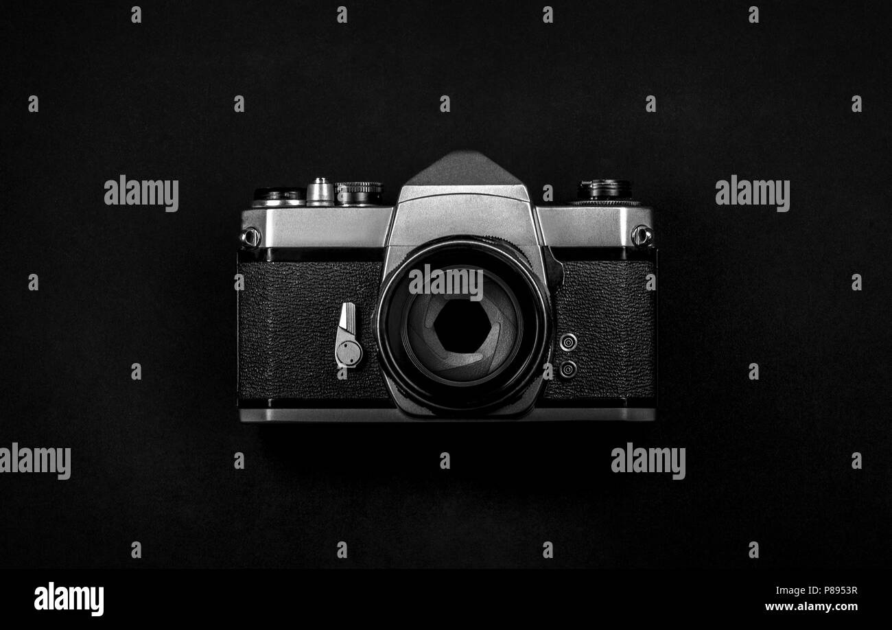Old SLR analog film camera with lens and aperture - Stock Image