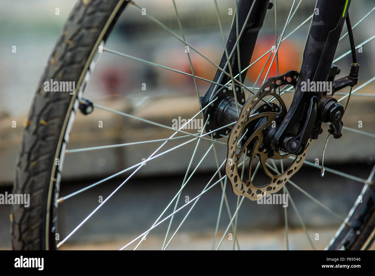 Details of a rear wheel of a modern bicycle with front brake gear. - Stock Image