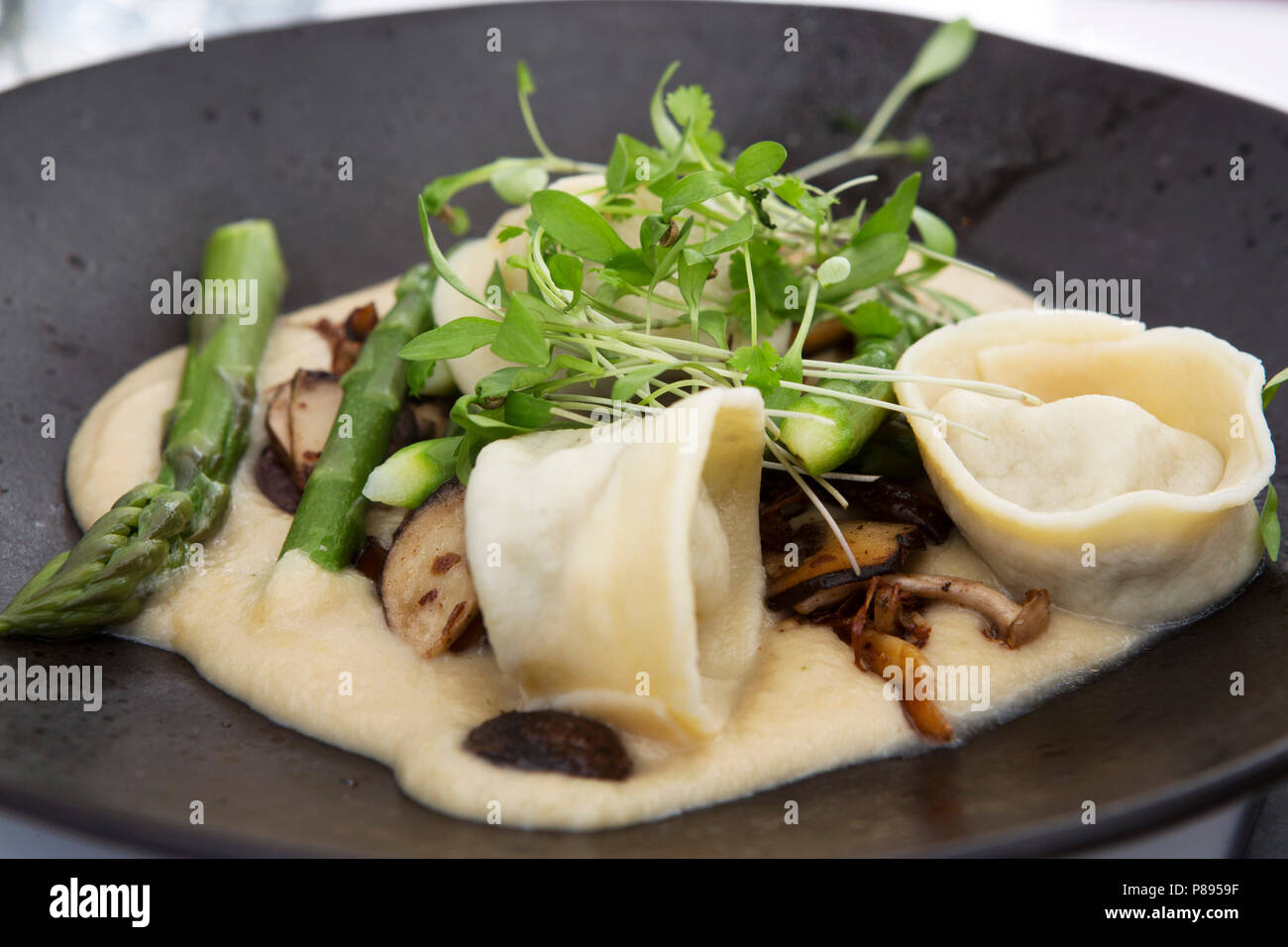 Pasta served with green asparagus during Dine by the Tyne, a version of Dinner in the Sky, dinner at a table suspended 100 feet above the River Tyne.  - Stock Image
