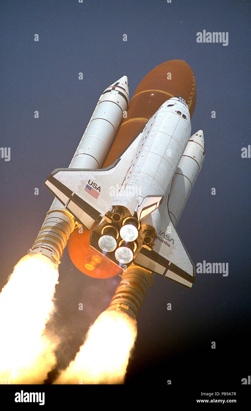 The Space Shuttle Atlantis thunders skyward from Launch Pad 39A. Liftoff of Mission STS-45 occurred at 8:13:40 a.m. EST, March 24, 1992. On board for the 46th Shuttle flight Atmospheric Laboratory for Applications and Science-1 (ATLAS-1). The launch is the second in 1992 for the Shuttle program and Atlantis' 11th flight. - Stock Image