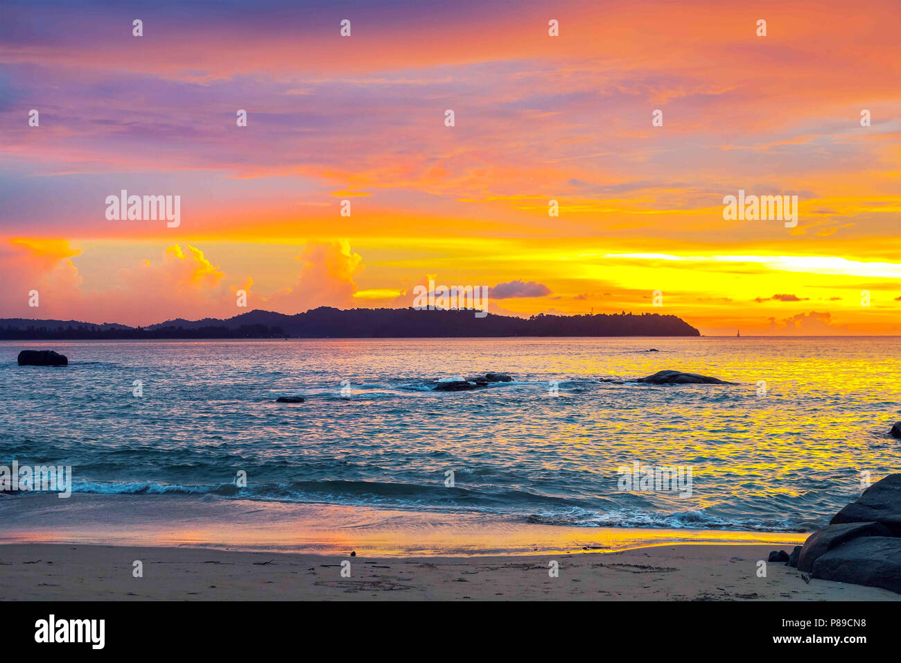 Colorful sunset over the sea in Thailand. - Stock Image