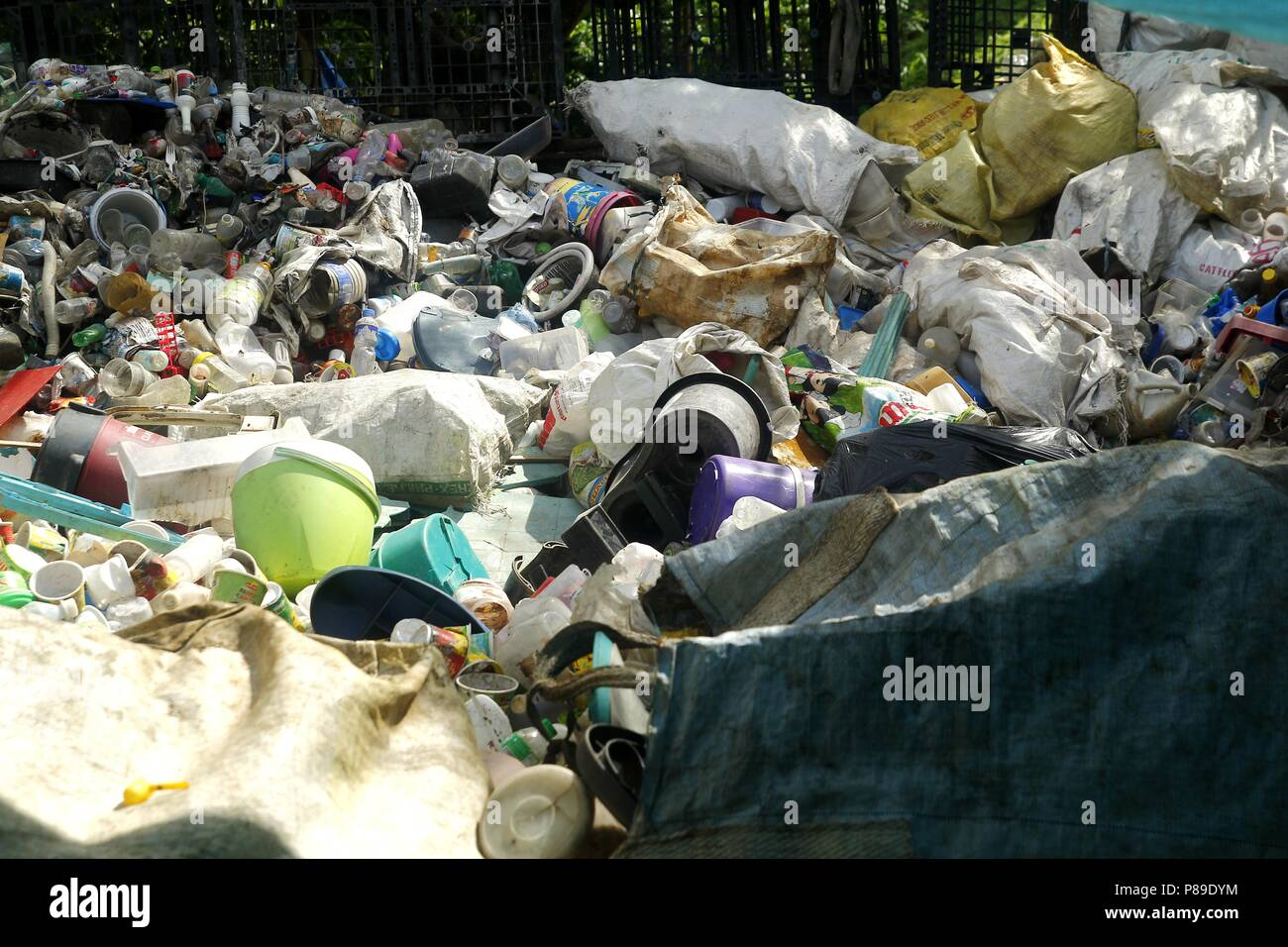 ANGONO, RIZAL, PHILIPPINES - JULY 4 2018: Assorted plastic waste materials at a materials recovery facility ready for sorting and segregation. - Stock Image