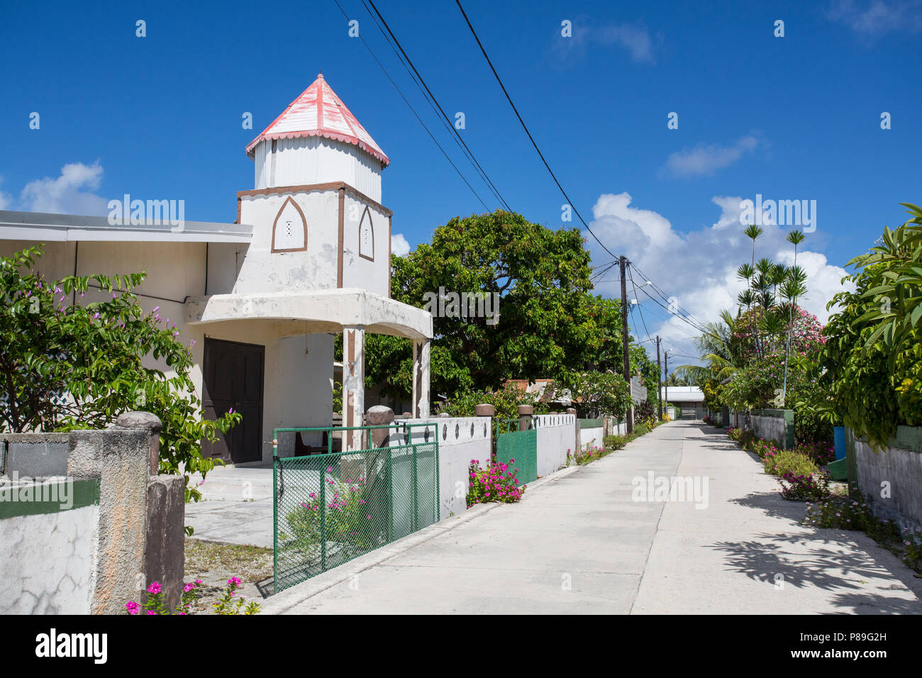 Church and Street on Manihi, Tuamotus - Stock Image