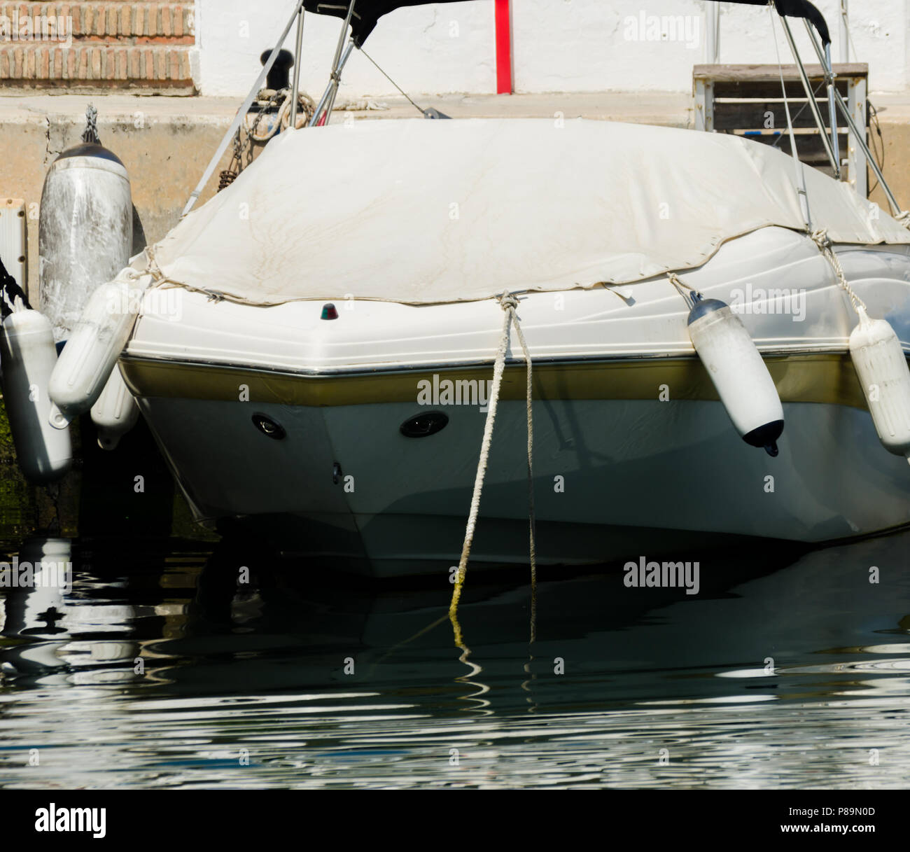closeup on elements of yachts and motor boats anchored in the harbor, hot day at harbor, marina - Stock Image