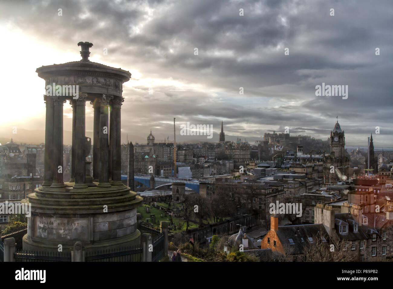 Cloudy skies on New Year's Eve 2017 (31 January 2017) atop Calton Hill with the Edinburgh skyline, Scotland, United Kingdom. HDR Image. Stock Photo