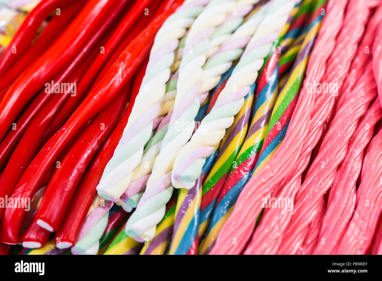 Wonderful candy sticks in any color and appearance. - Stock Image