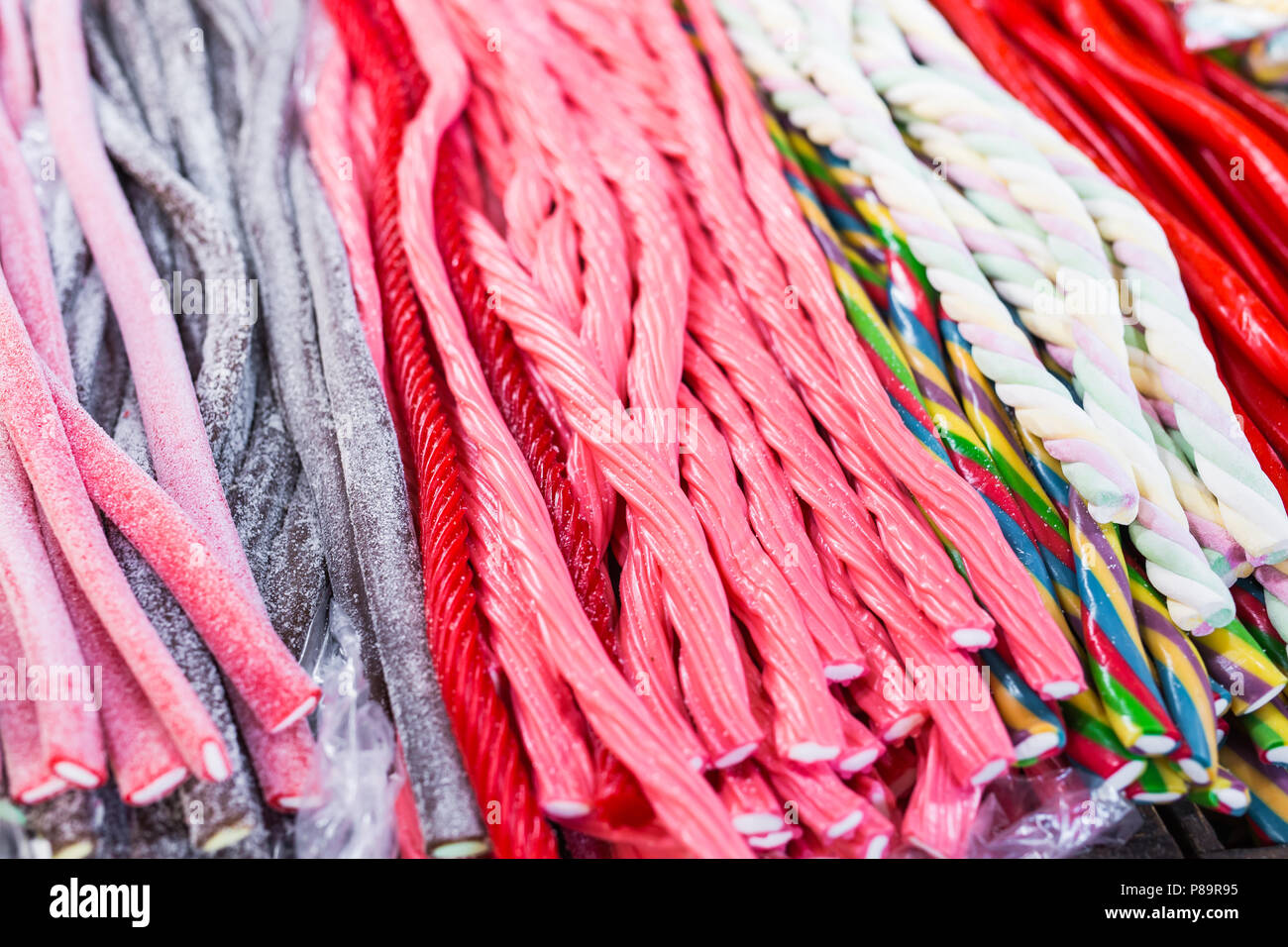 Candy sticks in any color and appearance. - Stock Image