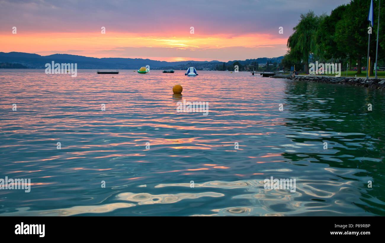 lake of Zurich sunset and bathing - Stock Image