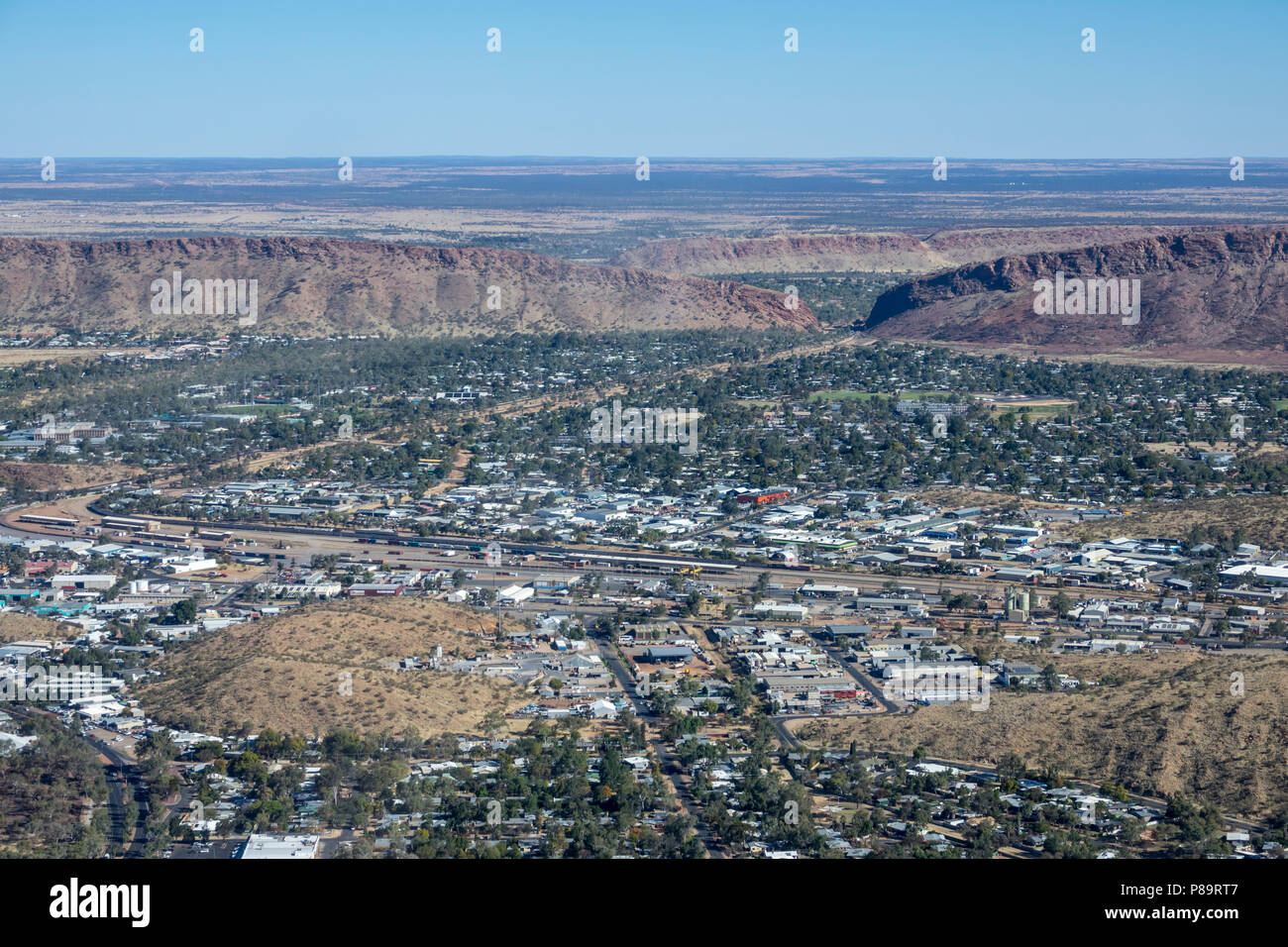 Aerial view over Alice Springs with The Ghan at Alice Springs station, Northern Territory, Australia - Stock Image