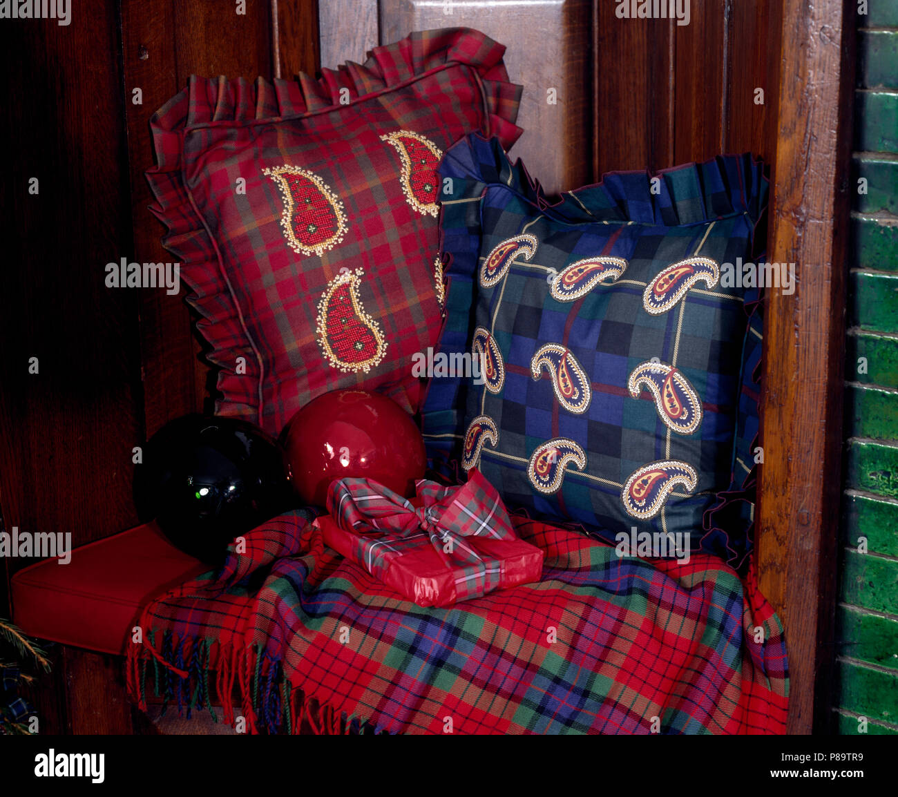 Red And Blue Paisley Appliqued Cushions On Chair With A Plaid Throw And A  Gift Wrapped Christmas Present