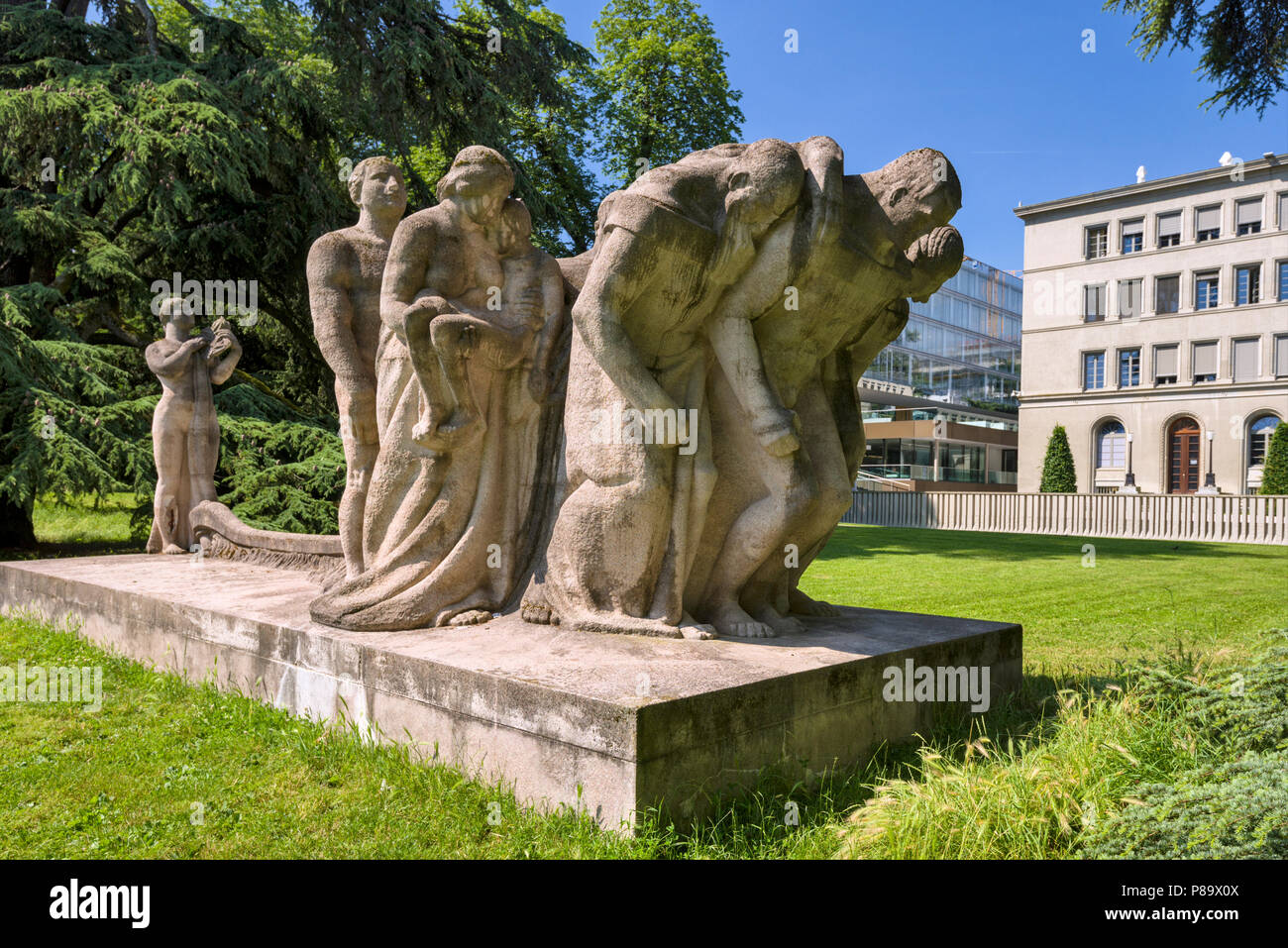 "Geneva, Switzerland - june 10, 2018 : The new building of the World Trade Organization (WTO) and in the park, the sculpture, entitled ""The Human Effor Stock Photo"