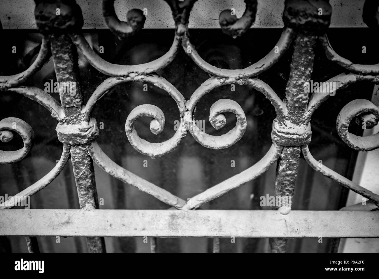 Dusty metallic shape, the sign of love from toreutics, wrought iron, part of theft protecting grid of basement window in downtown Sofia, Bulgaria - Stock Image