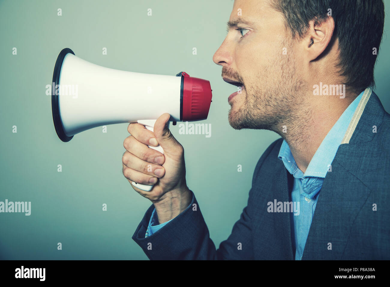 business leadership - businessman giving instructions with megaphone - Stock Image