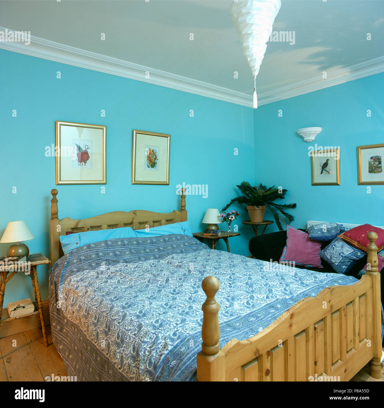 Blue+white Paisley bedcover on pine bed in pastel turquoise bedroom ...