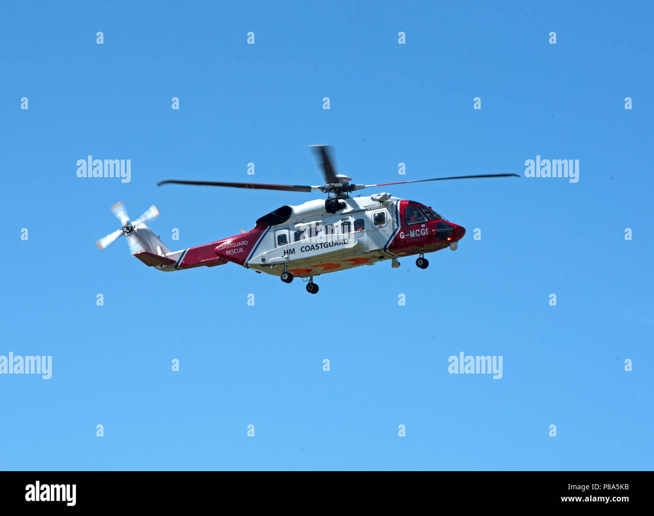 HM Coastguard S-92 rescue Helicopter returning to it's base at Inverness Airport in the Scottish Highlands. - Stock Image