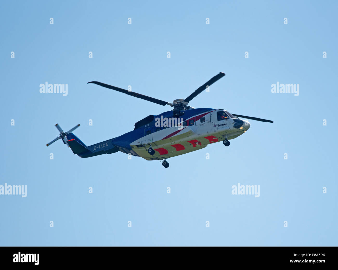 A Bristow S-92 Helicopter departs Aberdeen Dyce Airport for the North sea with worker ready to change shifts. - Stock Image
