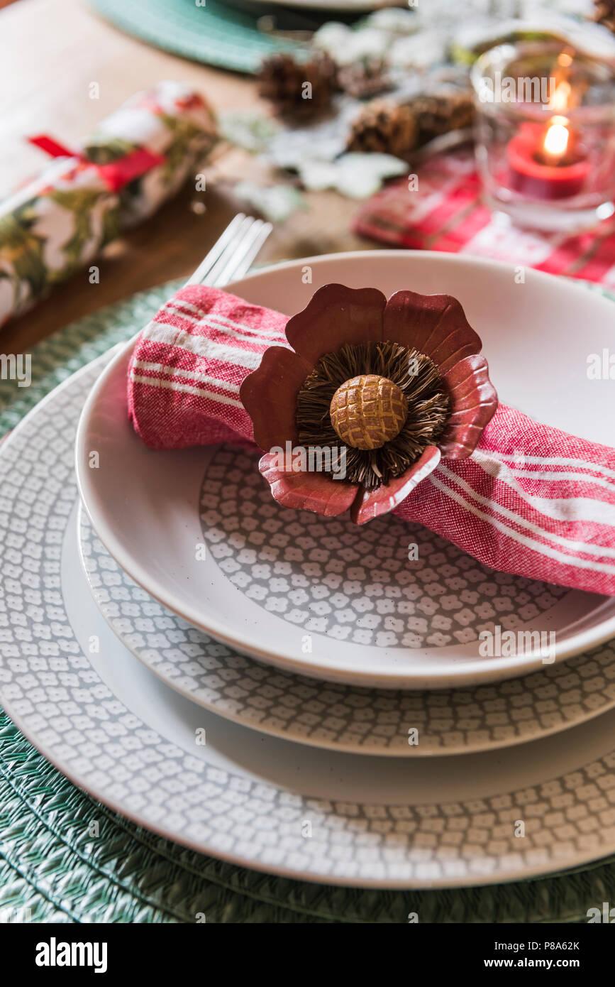Floral napkin ring on patterned bowl in regency home - Stock Image
