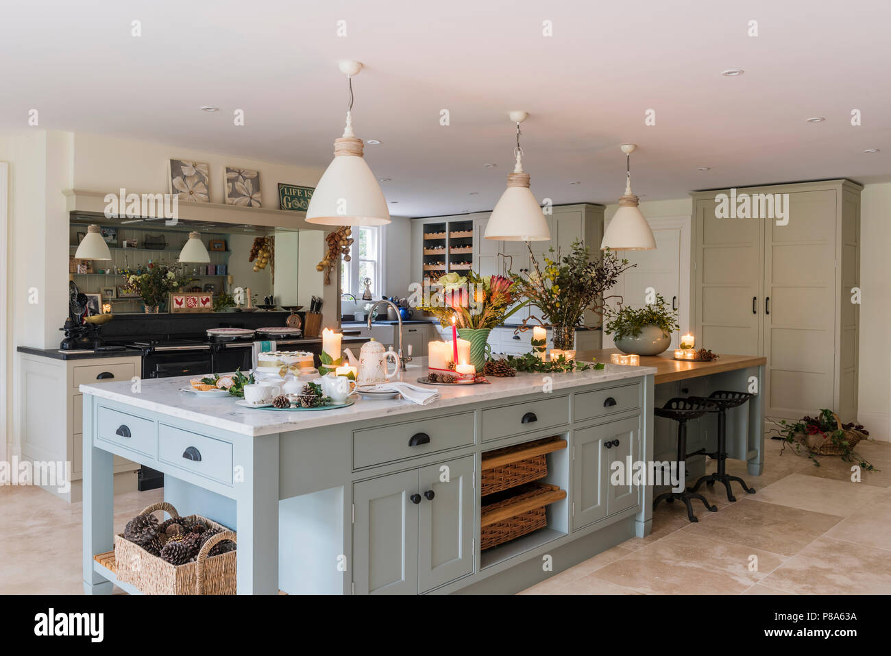 Cream Pendant Lights Hang Above Marble Topped Island Unit In Regency Farmhouse Kitchen Stock Photo Alamy