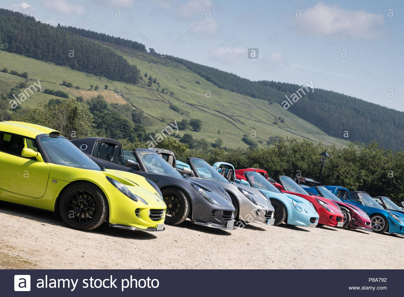 A row of Porsche sports cars in the North York Moors - Stock Image