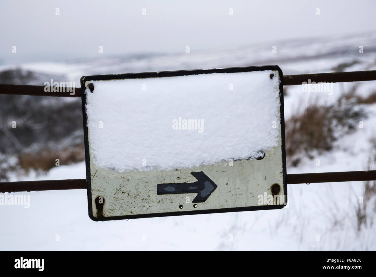 Snow covered road sign, Tarset, North Tyne valley, Northumberland National Park, UK - Stock Image