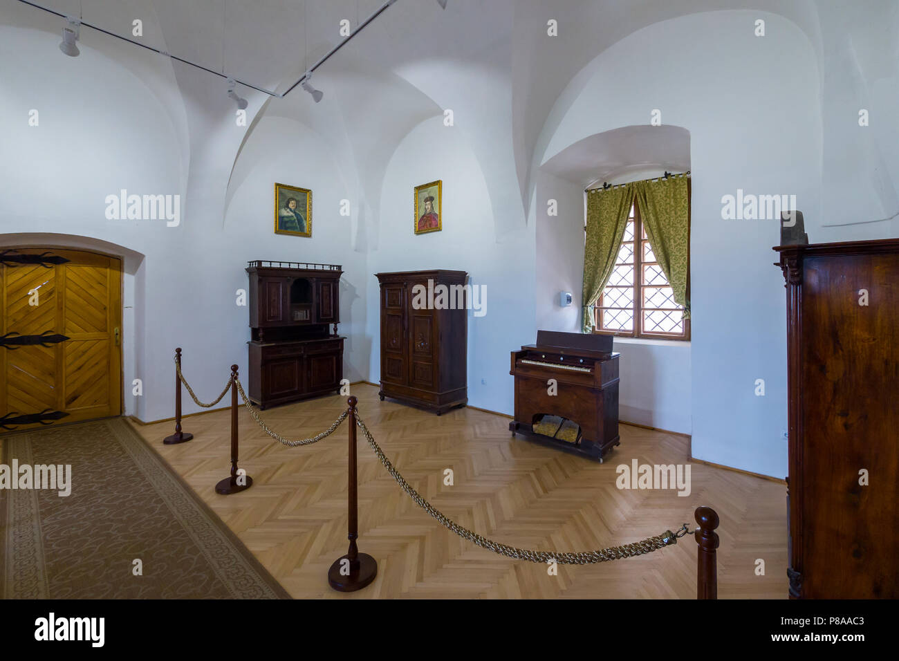 white museum exhibition hall with rarity wooden furniture ...