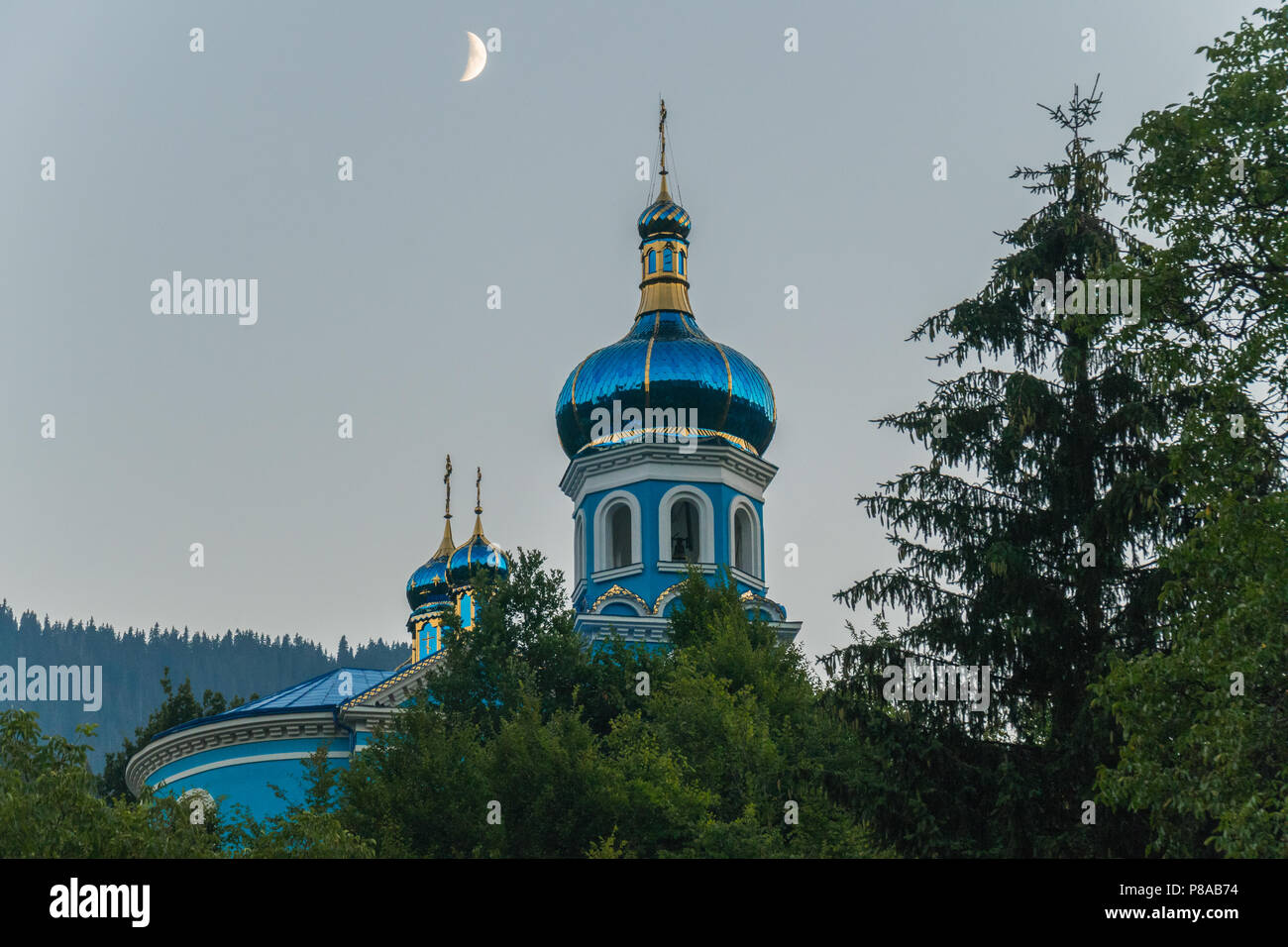 a majestic moon in a cloudless sky above the dome of the church . For your design - Stock Image