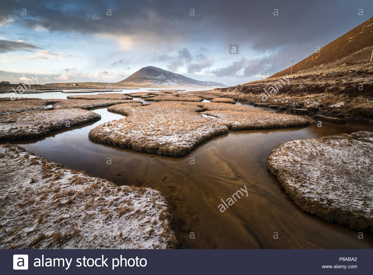 The Salt Flats between Scarista and Northton are probably the best example on the Island.  The leading lines of the flats leads to the mountain in the - Stock Image