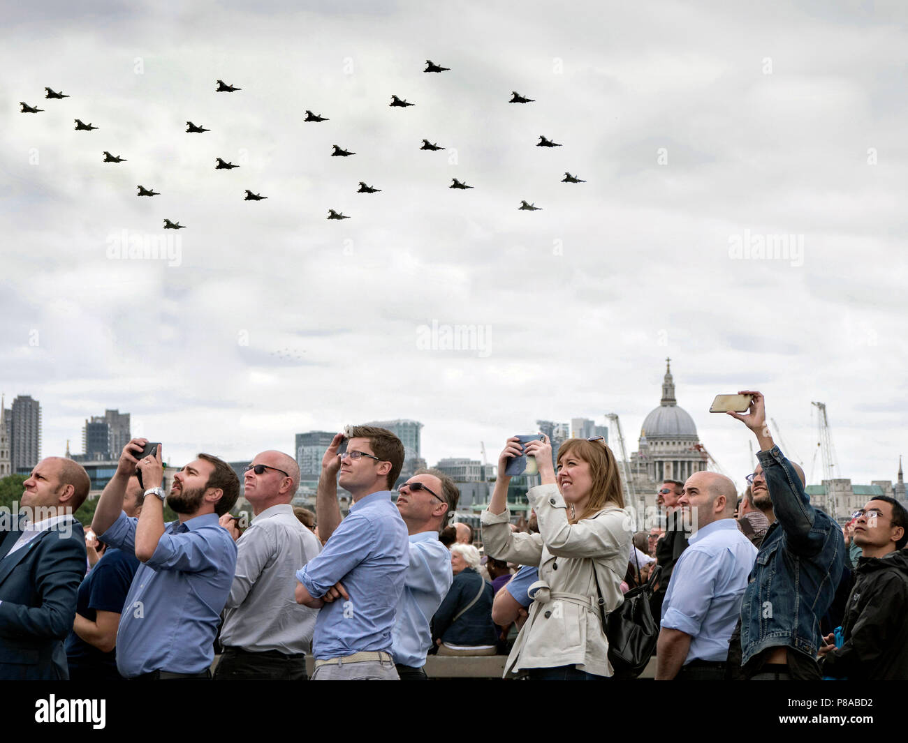 Typhoon FGR4 fighters in 100 formation flying over the City of London in the RAF 100 Fly past - Stock Image
