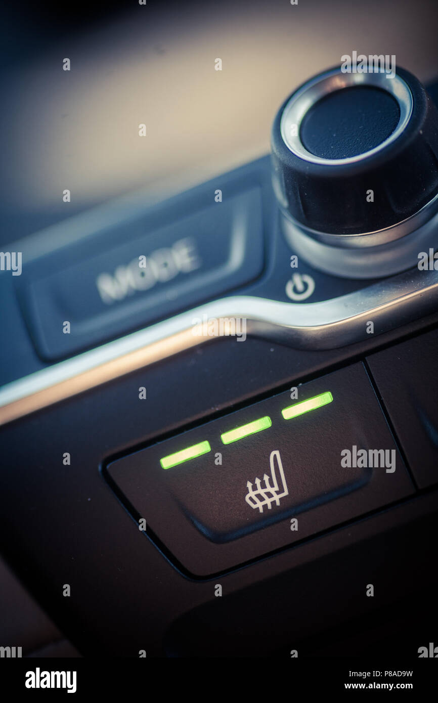Close up shot of a car's heated seats button. - Stock Image